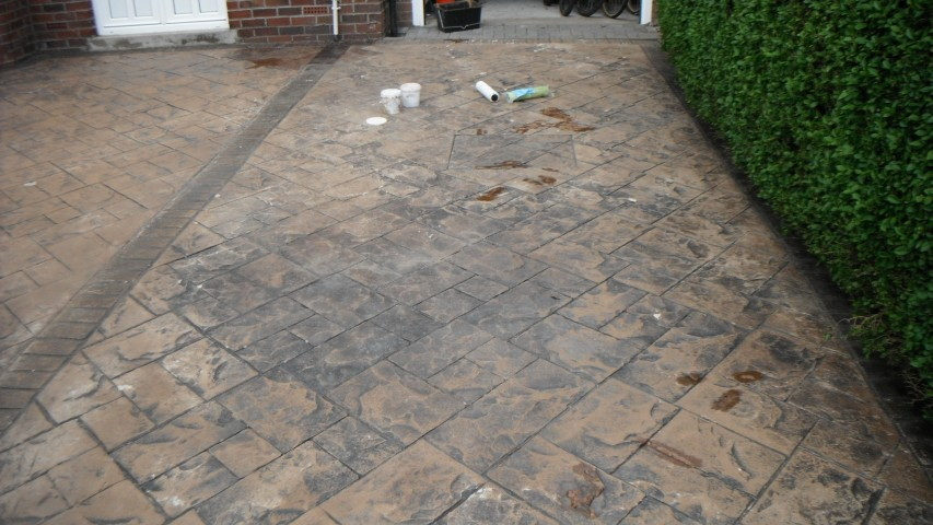 how to clean concrete driveway before sealing